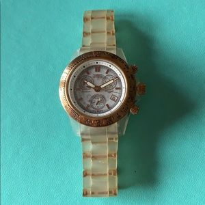 Invicta Ladies watch in rose gold face clear band